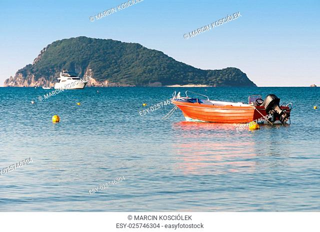 lifeboat in the laganas bay with the marathonisi island in the background, zakynthos island, greece