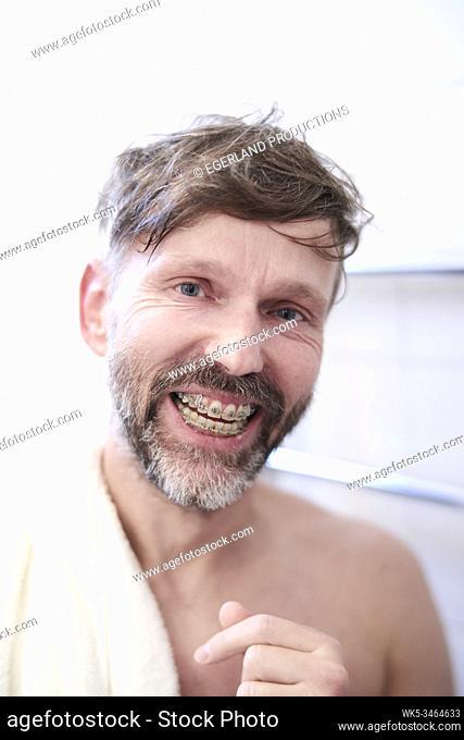 Portrait of smiling man with dental braces