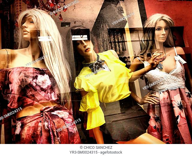 Mannequins decorate a window shop in Puebla, Mexico