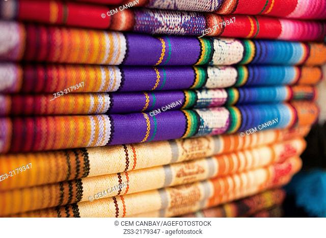 Close-up shot of coloured textiles in craft market, Otavalo, Quito Area, Imbabura Province, Ecuador, South America