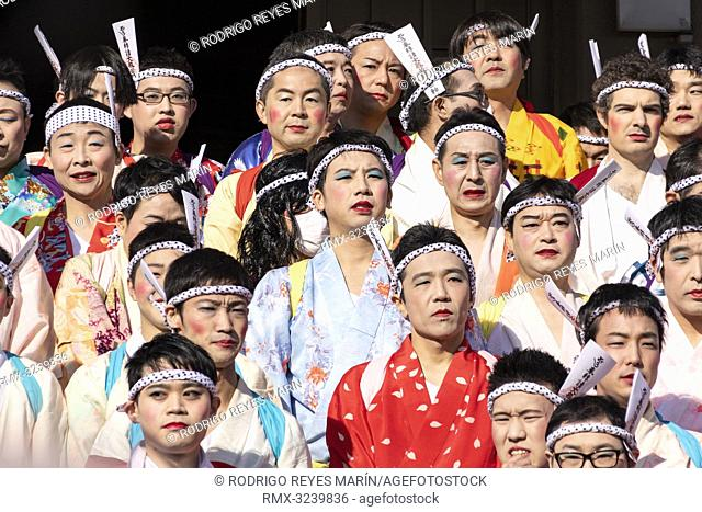 February 24, 2019, Tokyo, Japan - Participants dressed in women's kimonos and wearing makeup, pose for a group photo during the Ikazuchi no Daihannya festival...