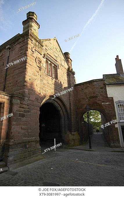 The abbey gate and gatehouse on the corner of abbey street and paternoster row Carlisle Cumbria England UK
