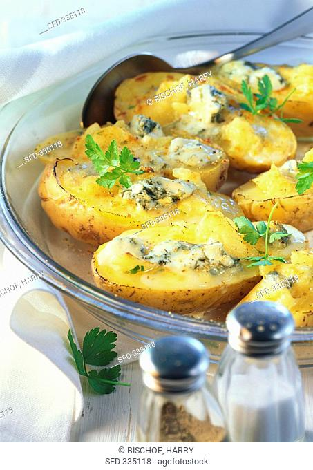 Baked potatoes with cheese filling