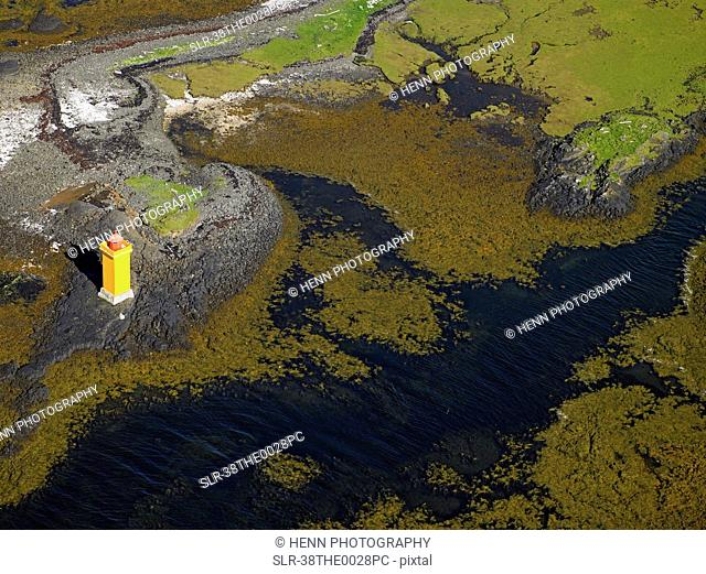 Aerial view of lighthouse on peninsula