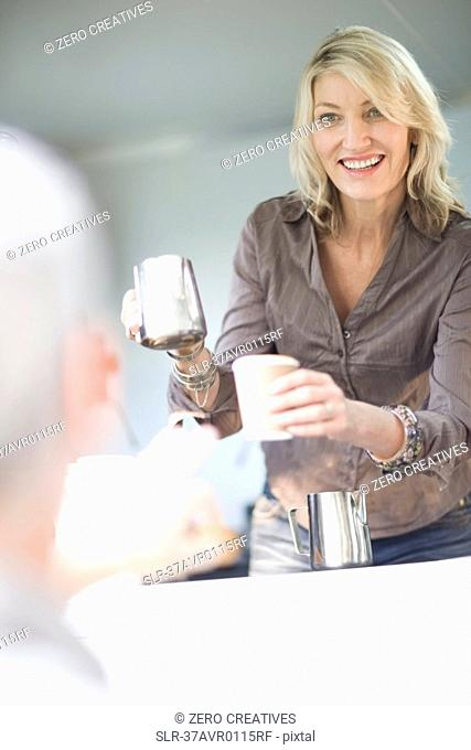 Woman serving coffee in food cart