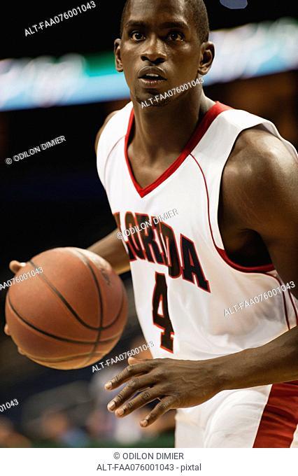 Basketball player dribbling ball
