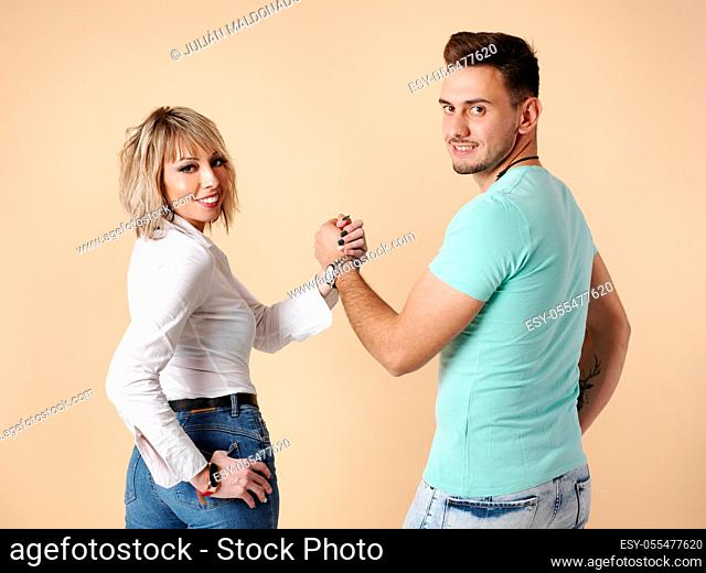 Two young men, a man and a woman, pose with positive aptitude and high-fives