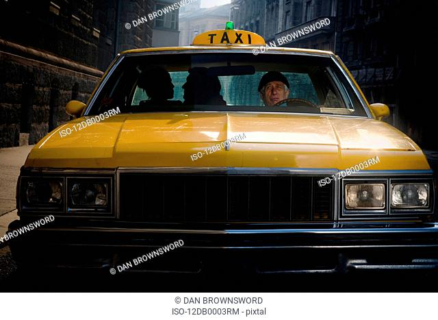 Taxi Driver Glancing at clients