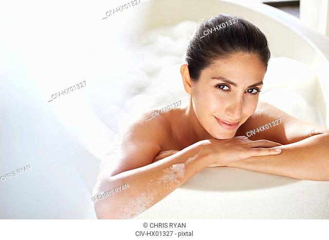 Portrait smiling woman enjoying bubble bath