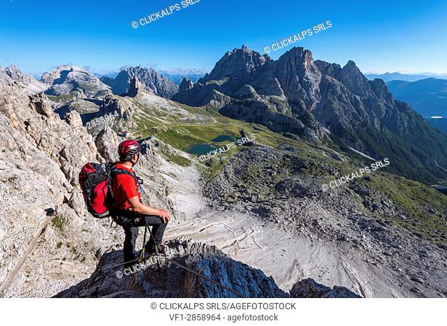 Sesto/Sexten, Dolomites, South Tyrol, province of Bolzano, Italy. Climber on the via ferrata De Luca-Innerkofler to the summit of Monte Paterno