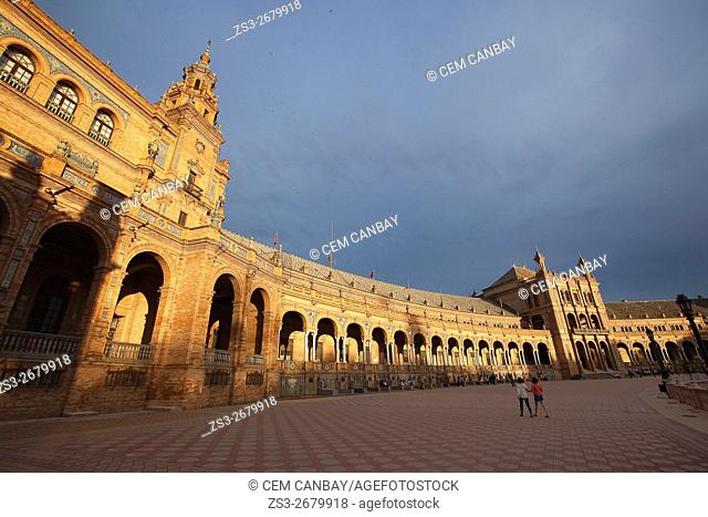 Visitors during the April Fair celebrations in Plaza de Espana at late afternoon, Seville, Andalusia, Spain, Europe