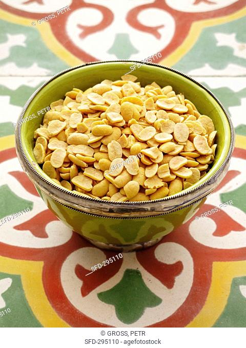 Dried soybeans in a green bowl