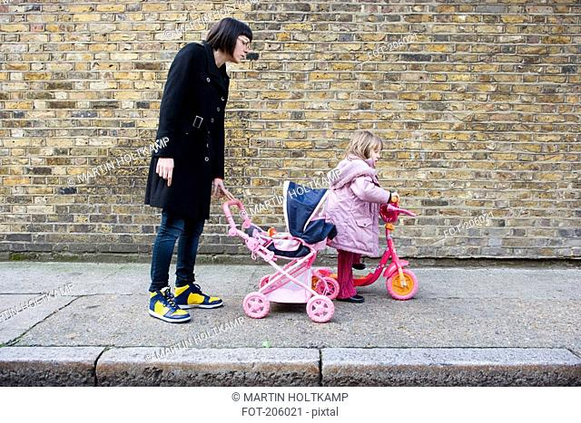 Mother and daughter on sidewalk