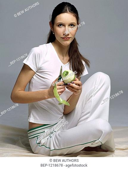 Girl peeling apple