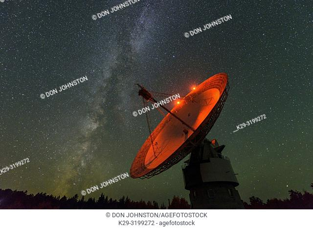 Night sky and the Radio telescope dish at Algonquin Radio Observatory, Algonquin Provincial Park, Nipissing Township, Ontario, Canada