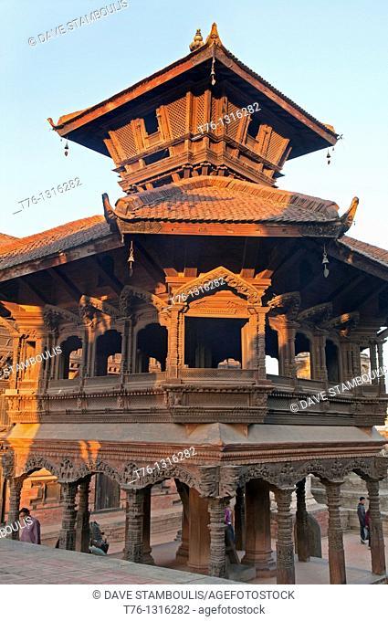 ornate carved windows of the Chyasalin Mandap Pavillion in Durbar Square in ancient Bhaktapur, near Kathmandu, Nepal