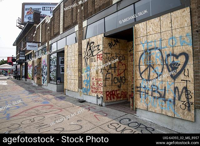 Minneapolis, Minnesota, Street art and graffiti on boarded up business at George Floyd memorial site