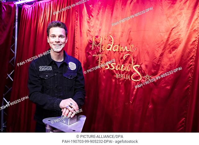 03 July 2019, Berlin: Felix Jaehn, DJ, is standing in front of a red curtain at a press conference to unveil his wax figure in the wax figure cabinet of Madame...