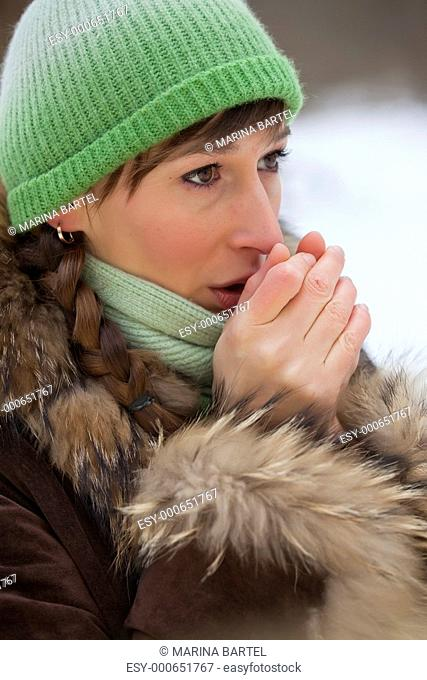 woman warms up her hands