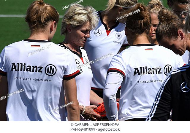 Germany's head coach Silvia Neid (C) talks to her team during a training session at the FIFA Women's World Cup 2015 at the Avenue Bois-de-Boulogne