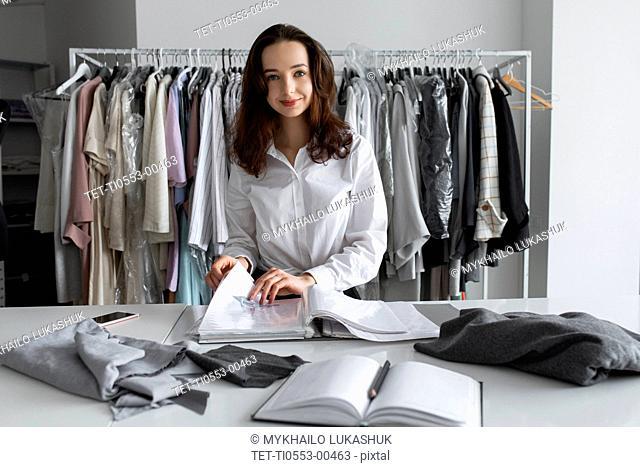 Fashion designer with portfolio in studio