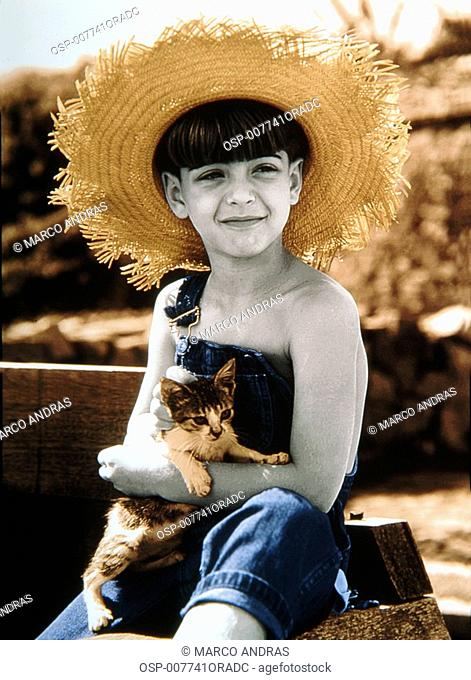 young boy holding a kitten