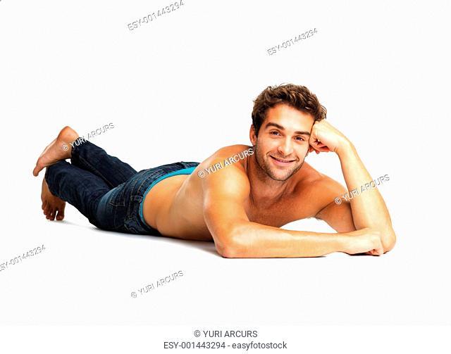 Sexy muscular man lying on white