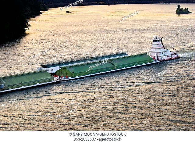 Barges and tugboat on Columbia River, heading west, Columbia River Gorge, from historic Bridge of the Gods between Oregon and Washington, USA