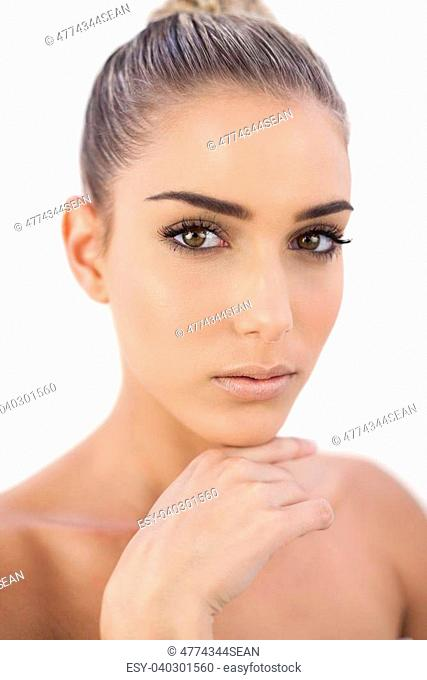 Thinking attractive woman looking at camera on white background