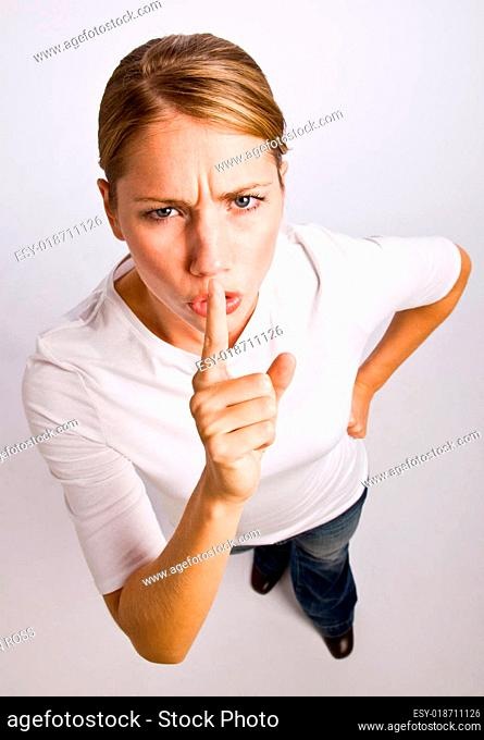 Woman making shhh gesture