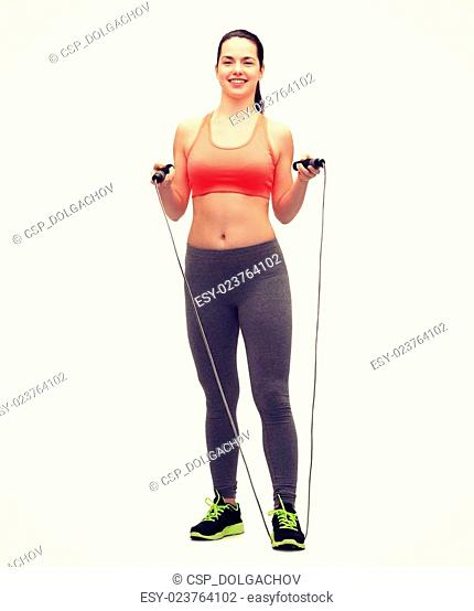 sporty woman with with skipping rope
