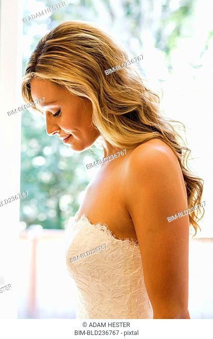 Caucasian bride looking down