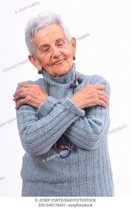 senior woman hugging on white background