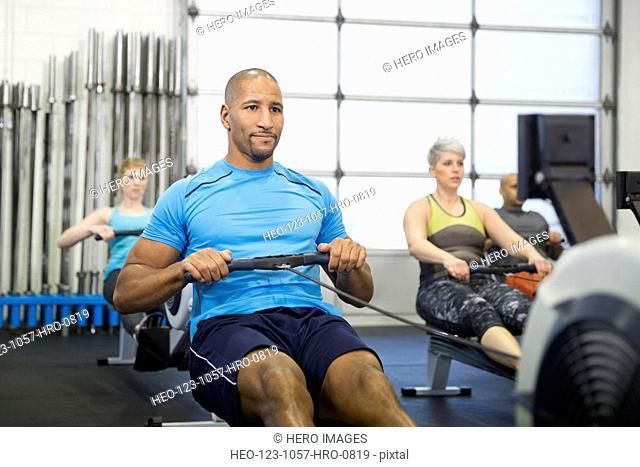 Man using rowing machine in gym