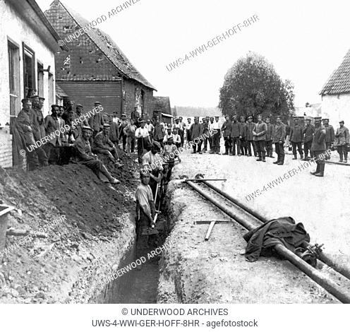 France: c. 1916 German engineers working to bring a fresh water pipe right up to the front line trenches in France