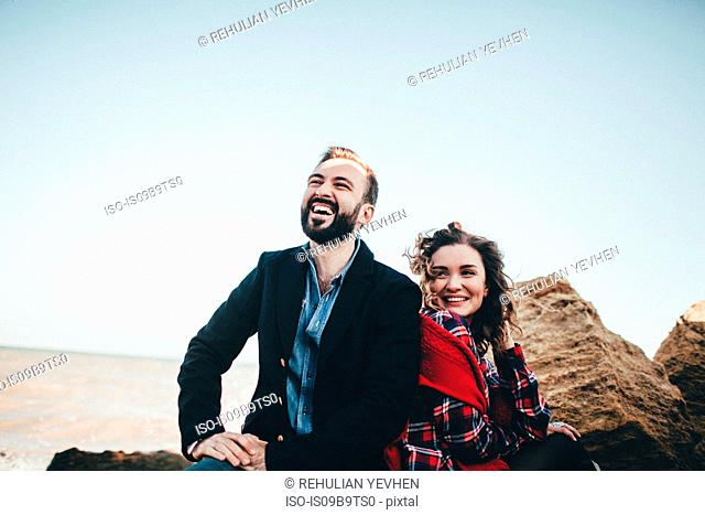 Mid adult couple laughing together on beach, Odessa Oblast, Ukraine