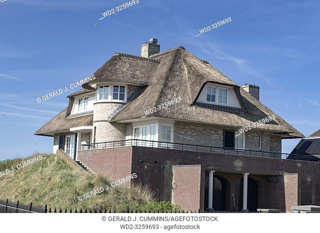 Netherlands, zeeburg, 2017, An stunning example of a thatched roof on a red bricked house looking out over the north sea