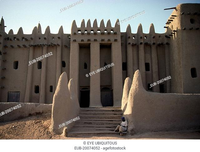 The Grand Mosque. Part view of exterior with plastered mud walls