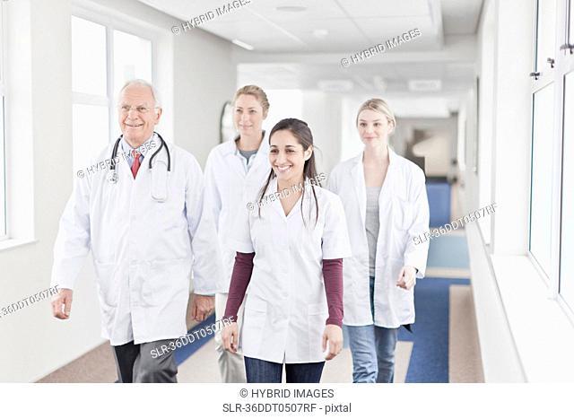 Doctors and nurses walking in hospital