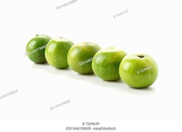 green lemon on white background