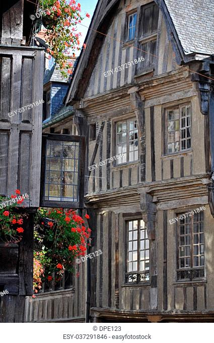 Medieval half-timbered buildings in the ancient french town of Dinan in Brittany. These old buildings are in the Place des Merciers (Haberdashers Square)~ One...