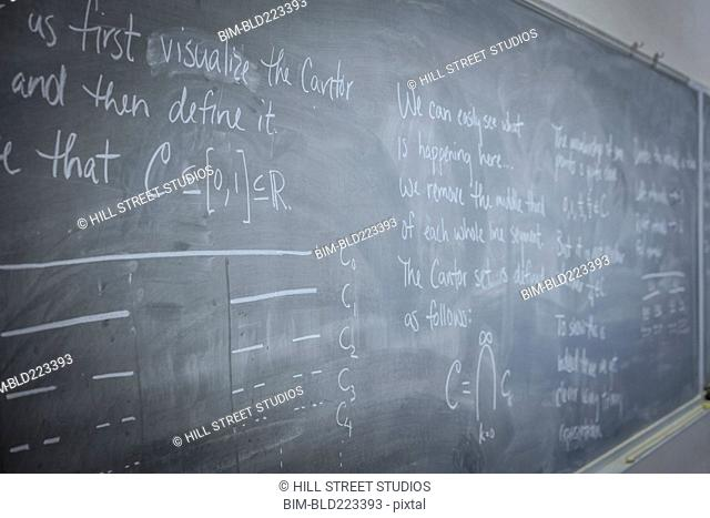 Equations on blackboard in classroom