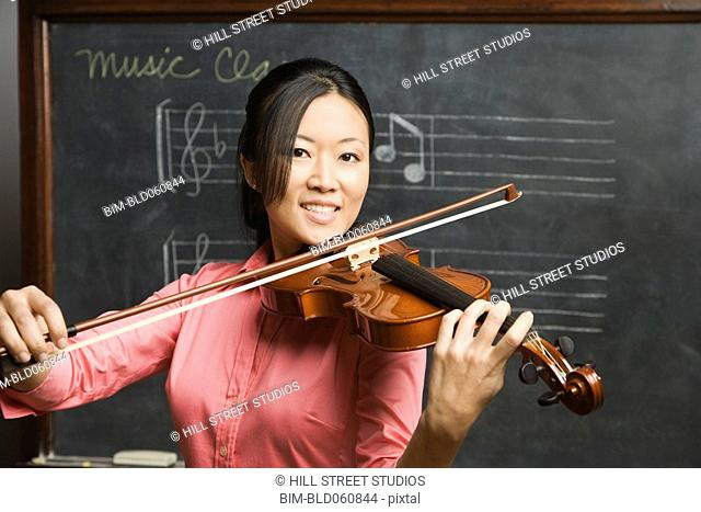 Asian woman playing violin