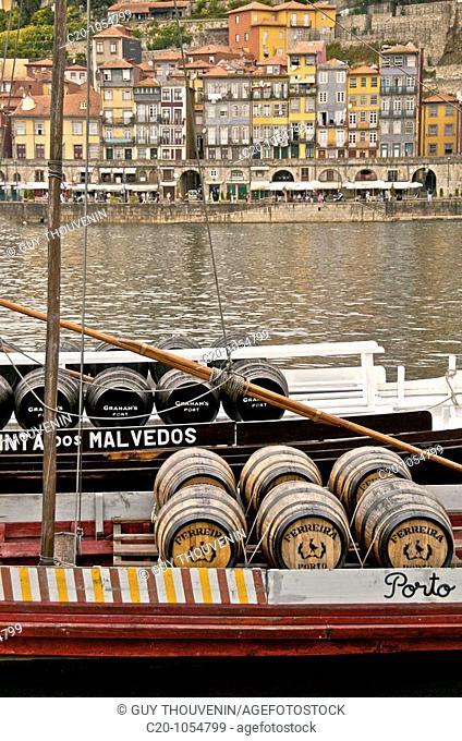 port wine barrels on a boat on river Douro Porto Portugal