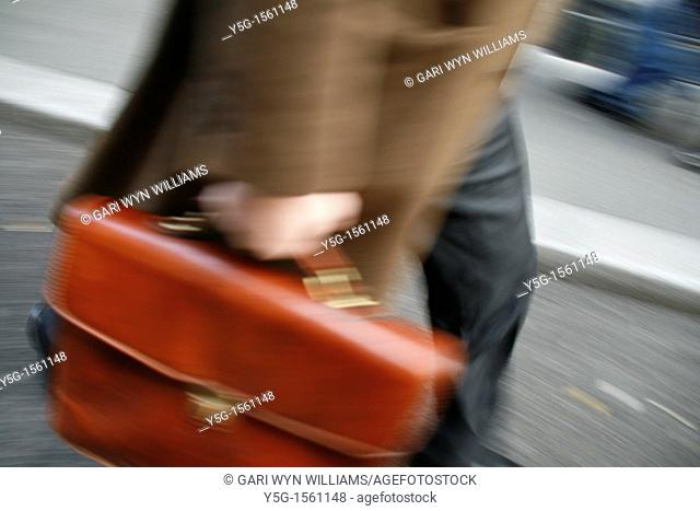 commuter with briefcase in town