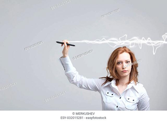 Young woman making magic effect - flash lightning. The concept of copywriting or writing