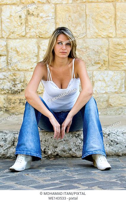 beautiful female sitting outdoors