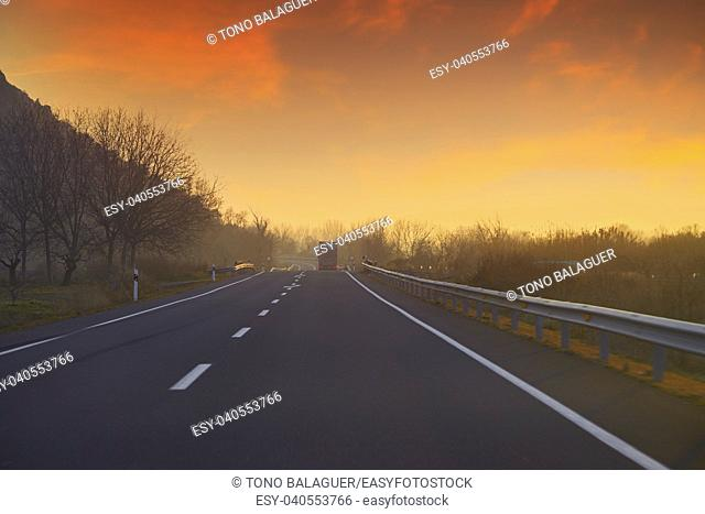 Sunset on the road with golden sky in Spain