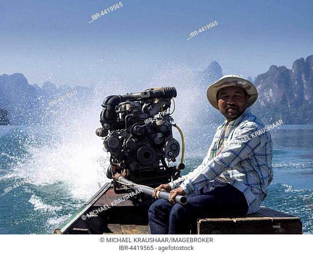 Man on powerboat, Ratchaprapha, Cheow Lan Lake, Khao Sok National Park, Surat Thani Province, Thailand
