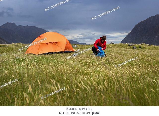 Hiker near tent